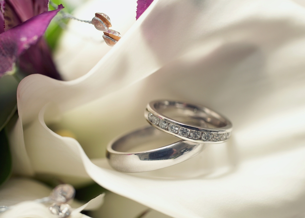 Closeup of Wedding Rings on Floor  Free Stock Photo