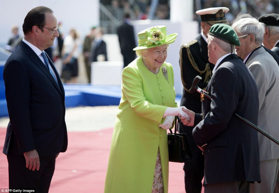 Queen Elizabeth II shakes hands with D-Day veterans alongside French President Francois Hollande during the Ouistreham International Ceremony